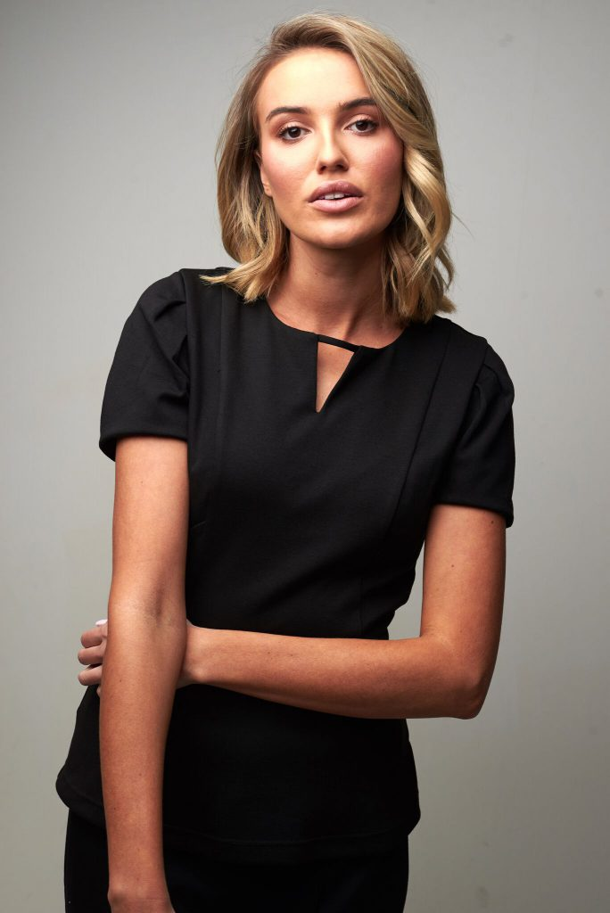 Dash salon top with pleat sleeve and notch neck.