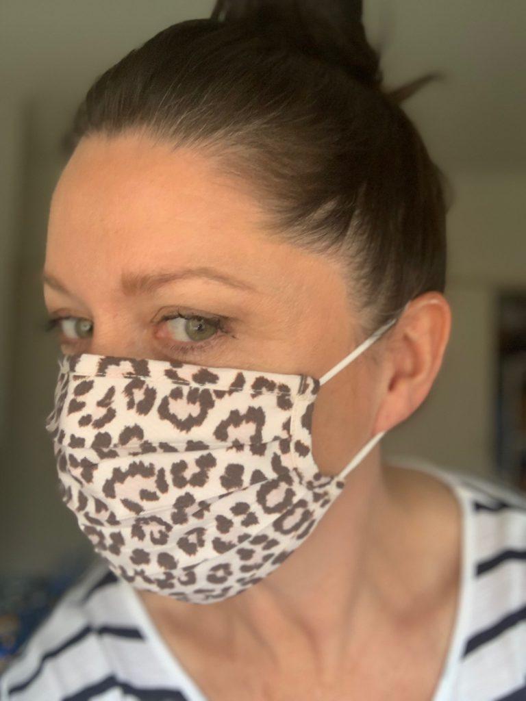 Leesa wearing a TUS leopard print mask